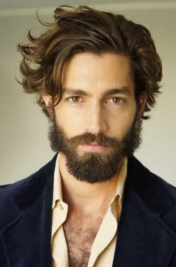 curly hairstyle men with beard