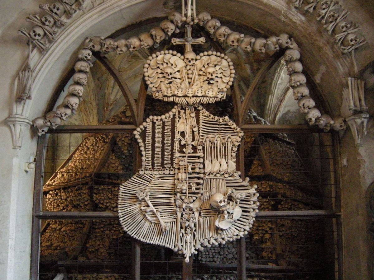 stand under the bone chandeliers of sedlec ossuary czech republic