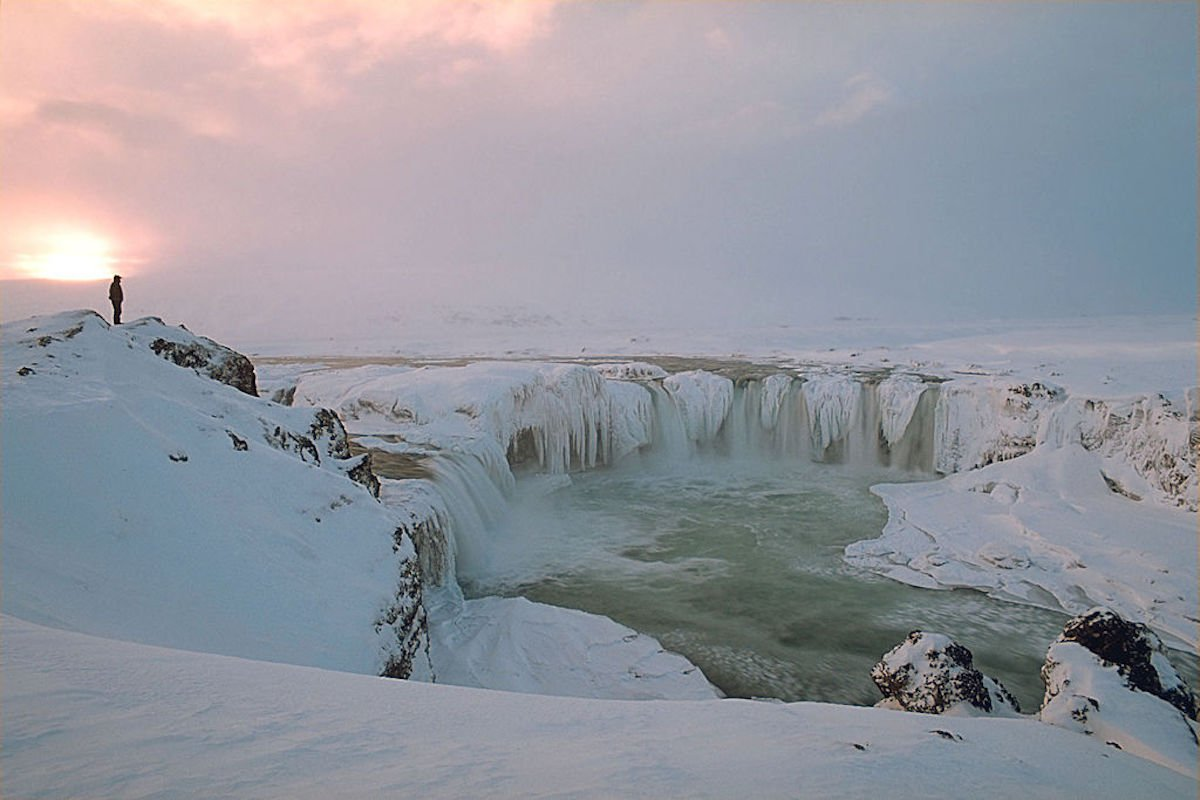 witness the sunset at goafoss iceland