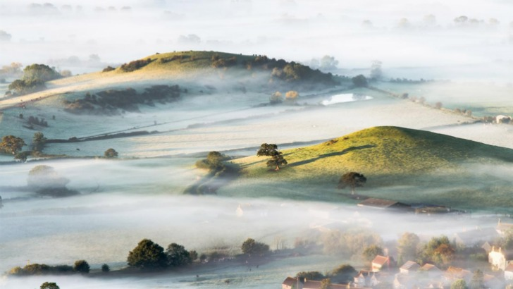 mist over countryside in southwest england photo by bob small