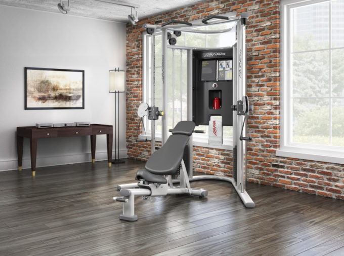 g home gym in living room brickwall