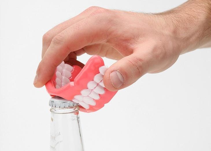 dişle şişe açmak